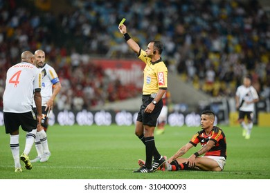 RIO DE JANEIRO, RJ - BRAZIL, AUGUST, 26, 2015 - Wilton Pereira Sampaio referee shows a yellow card during match between Vasco and Flamengo by The Brazil Cup in the Maracana Stadium