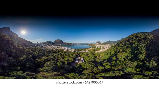 Rio de Janeiro seen from the slopes of the Corcovado mountain looking out over the popular touristic South neighbourhoods. 360 degree aerial panorama ready for use in 3D environment mapping and 360VR.