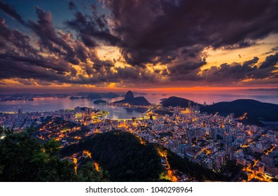 Rio de Janeiro skyline panorama at sunrise, Brazil. Sugarloaf Mountain and Botafogo Bay