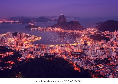 Rio de Janeiro skyline panorama at sunset, Brazil. Sugarloaf Mountain and Botafogo Bay