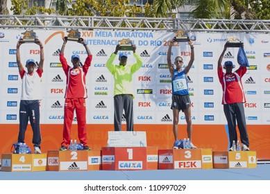 RIO DE JANEIRO-AUGUST 19:from left to right G.dos Santos;M.Korer;W.Erupe;S. da Silva;F. Robi at podium in XVI Meia Maratona Internacional do Rio de Janeiro, August, 19, 2012, Rio de Janeiro, Brazil.