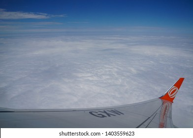 Rio de Janeiro/Brazil - 12/04/2015: Plane of the company Gol Airline flying over the clouds and seen through the window