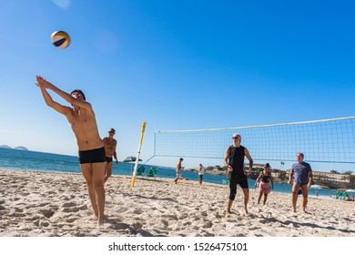 Rio de Janeiro/Brazil - August 17th 2019: People Practicing Outdoor Activities in Copacabana Beach During a Sunny Day with a Blue Sky - Beach Volleyball
