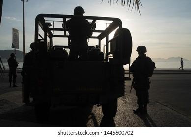 RIO DE JANEIRO,BRAZIL,MAY,12,2018: military intervention in rio de janeiro with army on the edge of copacabana beach rio de janeiro post card