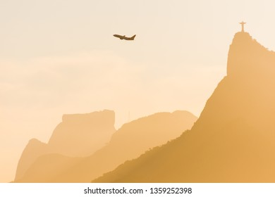 Rio de Janeiro/RJ/Brazil - January 08th 2019: Air Plane Crosses the Sky next to Christ The Redeemer Statue in Rio