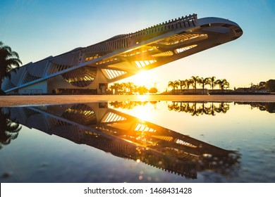 Rio de Janeiro/RJ/Brazil - June 29th 2019, Museum of Tomorrow Located in Mauá Square (Praça Mauá) during Sunrise and its Reflection on a Water Puddle