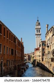 Rio dei Greci canal in Venice with the bell tower of the Church of Saint George 'Dei' Greci'