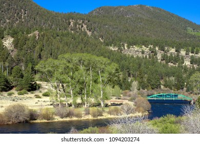 The Rio Grande flows through the Coller State Wildlife Area along the road to Creede in the San Juan Mountains of southern Colorado in early spring