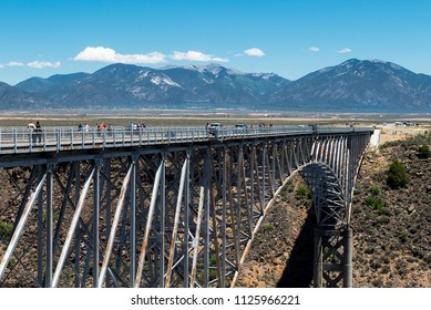 Rio Grande Gorge Bridge, near Taos, New Mexico. With Mountains and Blue Skies. Also known as the High Bridge.