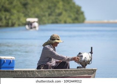 Rio Grande, Puerto Rico, USA, 16 March 2016 - Fisherman on a skiff getting ready to fish in the river's calmed waters.