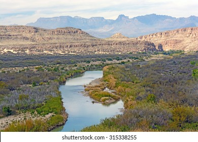 Rio Grande River meandering through a desert canyon of Big Bend National Park in Texas