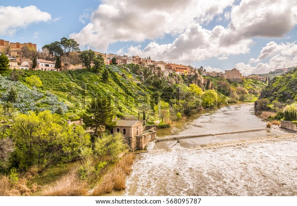 The Rio Tajo running on the South-West side of the historical city Toledo, Spain