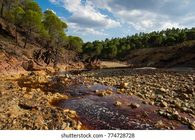 Rio Tinto in Huelva district, Andalusia, Spain. Amazing color of the rocks and water. Red river. Beautiful landscape Iron and other minerals in the water make it look red, purple, yellow stones.