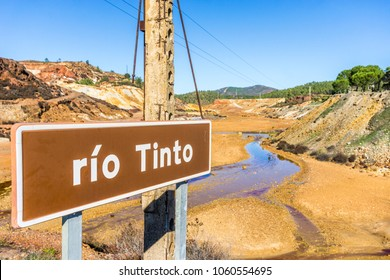Rio Tinto information sign with the river in the background, Andalusia, Spain