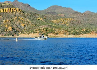 RIO VERDE, AZ - JULY 15: Sheriff police boat on duty patrolling the water near SB Cove at Bartlett Lake Reservoir on July 15, 2016 in Rio Verde, Arizona.