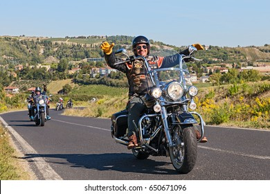 "RIOLO TERME, ITALY - SEPTEMBER 22: happy biker leads a group of bikers riding Harley Davidson in motorcycle rally ""Sangiovese tour"" by Ravenna Chapter on September 22, 2013 in Riolo Terme (RA) Italy"