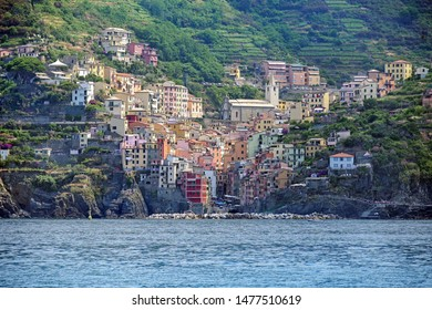 Riomaggiore, an ancient village with colorful houses from the Cinque Terre in the mountains on the Mediterranean sea coast, famous tourism destination in Liguria, Italy