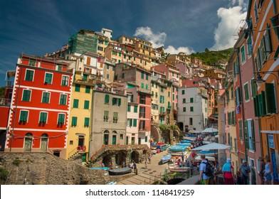 Riomaggiore, Cinque Terre, Italy - 06 07 2018: Picturesque colorful fishing village Riomaggiore, one of five at Cinque Terre