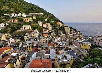 Riomaggiore of Cinque Terre, Italy - Traditional fishing village in La Spezia, situated in a coastline of Liguria of Italy. Riomaggiore is one of the five Cinque Terre travel attractions.