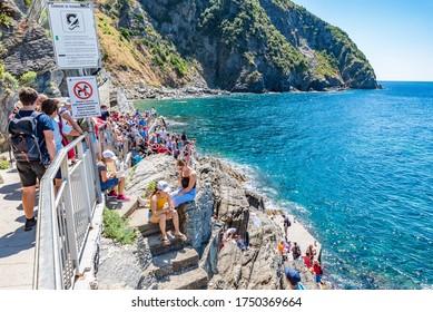 RIOMAGGIORE, ITALY - JULY 16, 2019: Riomaggiore is a village and comune in the province of La Spezia, Italy. It is the first of the Cinque Terre one meets when travelling north from La Spezia.