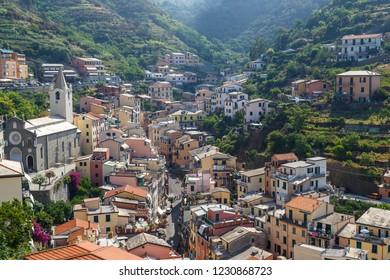 RIOMAGGIORE / ITALY - JULY 2015: View to coastal Riomaggiore village in Cinque Terre, Italy