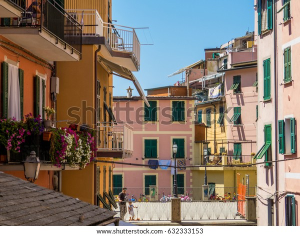 RIOMAGGIORE, ITALY - JULY 29, 2016 - Sunny view of a picturesque Italian courtyard.