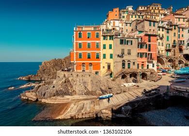 RIOMAGGIORE, ITALY - MARCH, 2019: Tourists visit Riomaggiore village, Cinque Terre (Italian Riviera Liguria), Italy - famous italian travel destinations