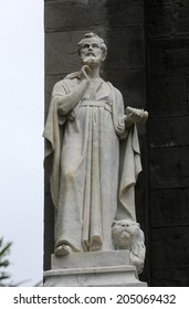 RIOMAGGIORE, ITALY - MAY 02, 2014: Saint Mark the Evangelist statue, Saint John the Baptist church in Riomaggiore, Liguria, Italy one of the Cinque Terre villages, UNESCO World Heritage Sites