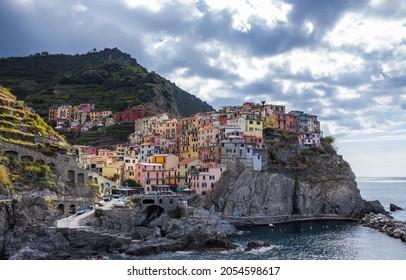 Riomaggiore, Italy - October 3, 2021: Riomaggiore colorful fishing village, seascape in Five lands, Cinque Terre National Park, Liguria, Italy