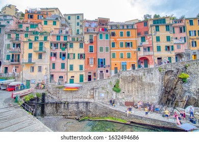 Riomaggiore, Italy- September 17, 2018: View of the city in the Ligurian sea of the ancient and typical Cinque Terre village in summer