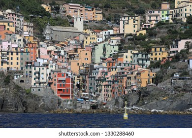 RIOMAGGIORE, ITALY/EUROPE - SEPTEMBER 4, 2018:   Riomaggiore is one of the five UNESCO villages that make up the Cinque Terre region of Italy.  This coastal port is a popular travel destination.