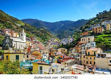 Riomaggiore, Liguria, Italy fisherman village, colorful houses on sunny warm day. Monterosso al Mare, Vernazza, Corniglia, Manarola, and Riomaggiore, Cinque Terre National Park UNESCO World Heritage