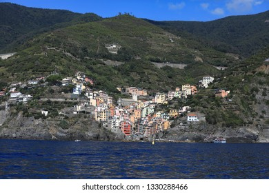 Riomaggiore is one of the five UNESCO villages that make up the Cinque Terre region of Italy.  This coastal port is a popular travel destination. This is the view from the arriving ferry.