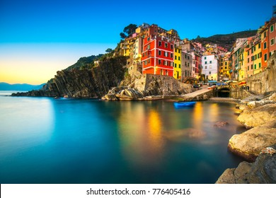 Riomaggiore town, cape and sea landscape at sunset. Seascape in Cinque Terre National Park, Liguria Italy Europe. Long Exposure