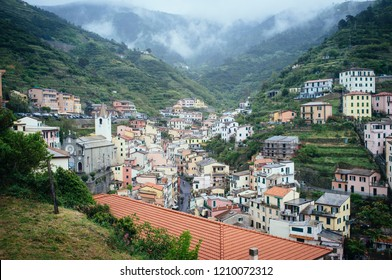 Riomaggiore traditional houses with Church of San Giovanni Battista in Liguria, Italy