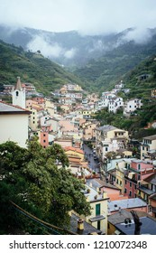 Riomaggiore traditional houses with the montains at its back in Liguria, Italy
