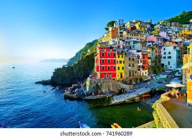 Riomaggiore village along the coastline of Cinque Terre area on a sunny day in Italy.