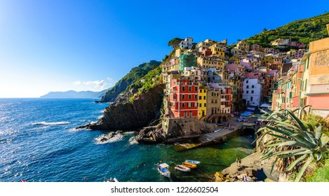 Riomaggiore - Village of Cinque Terre National Park at Coast of Italy. Beautiful colors at sunset. Province of La Spezia, Liguria, in the north of Italy - Travel destination and attractions in Europe.