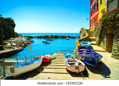 Riomaggiore village street, boats and sea in Five lands, Cinque Terre National Park, Liguria Italy Europe.