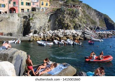 RIOMAGGIORE,LES CINQUE TERRE,LIGURIA.ITALIA. August 2017  Enjoying the summer and the heat on the beach of Riomaggiore, beautiful town in the Liguria area. Italy