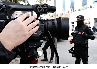 Riot police bloc protesters as they surround the headquarters of a media company linked to a government critic, enforcing a court order to seize the business, in Istanbul, Oct. 28, 2015.