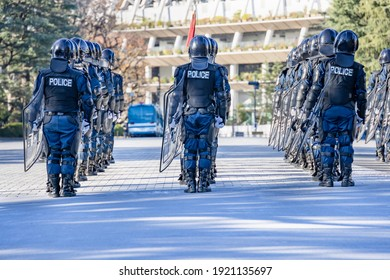 Riot police march training scene