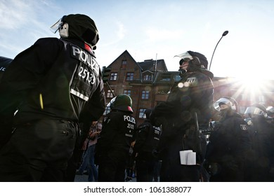 Riot police officers check the crowd during a protest against the G-20 summit in Hamburg, Germany on Jul. 6, 2017
