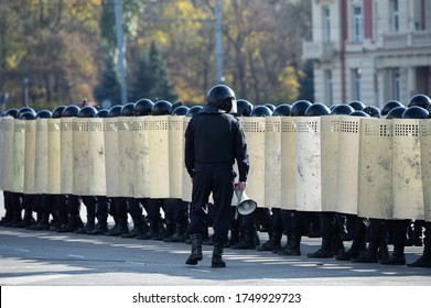 riot police squad with shields and helmets in the streets