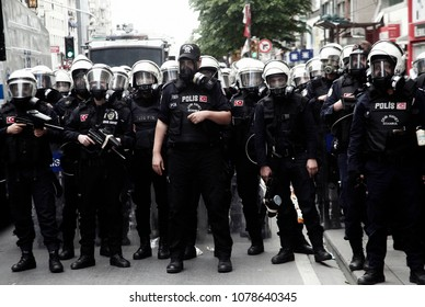 Riot police stand by near a rally by the labor unions in Istanbul, Turkey May 1, 2014