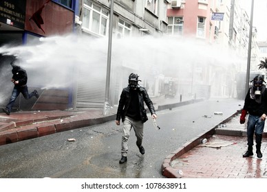 Riot police use water cannon and tear gas to desperse workers during a Labor Day demonstration in Istanbul, Turkey May 1, 2014