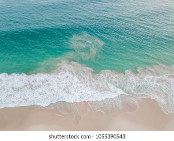 Rip current in the ocean. Turquoise water on the beach aerial view