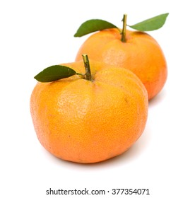 rip tangerine fruits with leaves isolated on white background