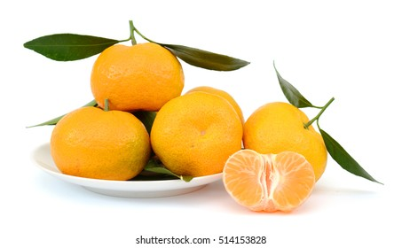 rip tangerine fruits on white plate isolated on white background