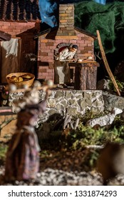 Riparbella Toscany Italy, December 2018. Miniature figurine backing bread